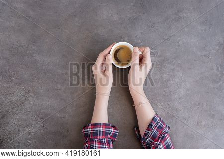 Female Hands In Plaid Shirt Holding A Cup Of Americano Coffee. Love Coffee Concept Background With C