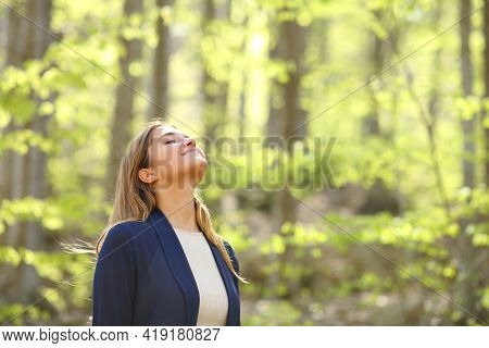 Relaxed Casual Woman Breaths Fresh Air In A Green Forest