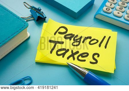 Payroll Taxes On The Yellow Memo Stick And Calculator.