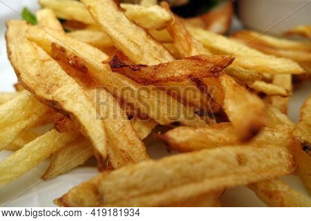 Fried Potato Close-up With Blur Effect. Fast Food Background.