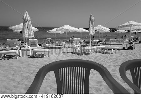 View On The Beach From The Bar Table In Black And White. Seasonal Natural Background.