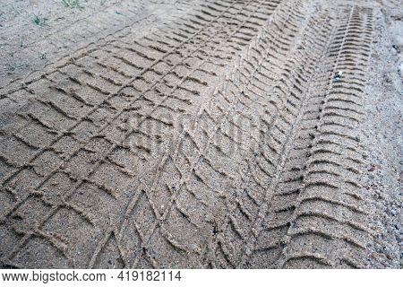 Tyre Tracks On Sandy Dirty Road. Seasonal Natural Background.