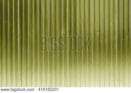 Metal Sheet Fence Texture In Yellow Color. Architectural And Construction Background