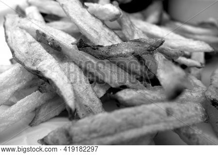 Fried Potato Close-up With Blur Effect In Black And White. Fast Food Background.
