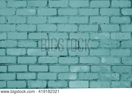 Pattern Of Brick Wall With Blur Effect In Cyan Tone. Abstract Architectural Background And Texture F