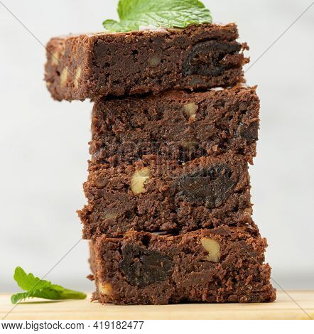 Stack Of Square Baked Brownie Chocolate Pie Pieces On Wooden Board, Delicious Dessert