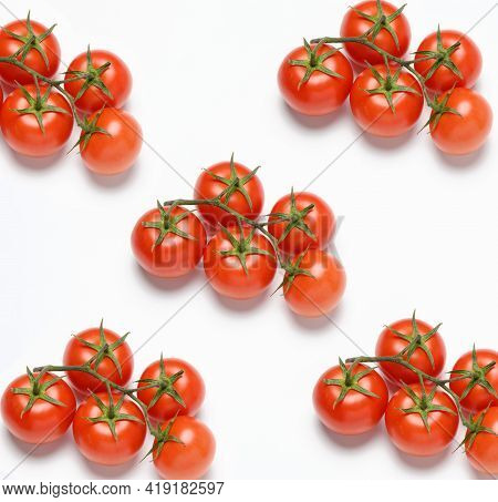 Red Ripe Tomatoes On A Green Branch On White Background, Healthy Vegetable, Top View