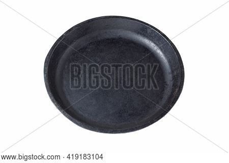 Old Round Cast Iron Frying Pan Without Handle Isolated On White Background. The Concept Of The Kitch