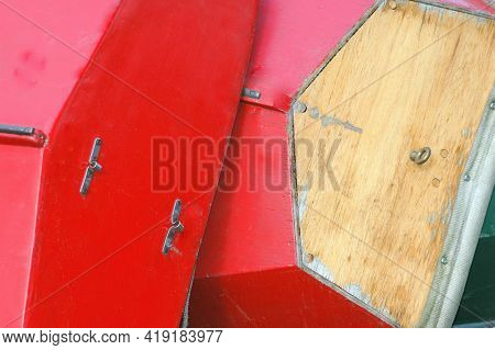 Handmade Color Red Wooden Boats Being Built Outside.