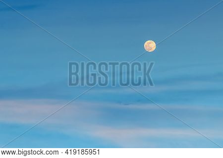 Large Pale Full Mon Over Blue Pink Clouds In The Evening Sky. Amazing Tranquil Twilight Skyscape. Аs