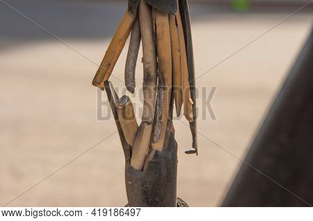 Broken old ground electric cord. Dangerous damage power electrical cable that can make electric leak and shock. Unsafe work concept