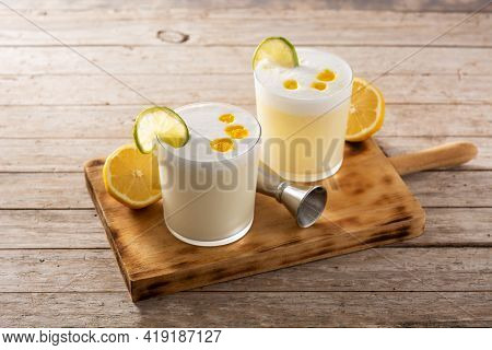 Pisco Sour Cocktail On Wooden Table. Traditional Peruvian Cocktail