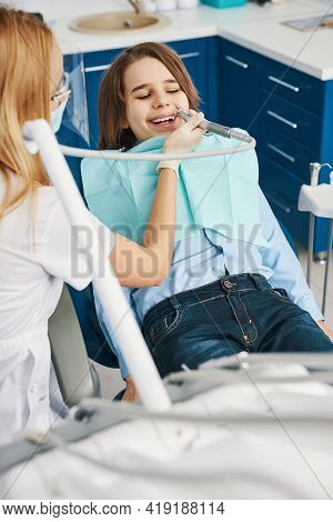Child Having Fun While Stomatologist Taking Off His Tooth Decay
