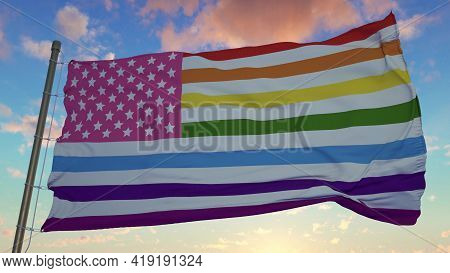 Gay Flag Symbol Of Gay Pride In America. United States Rainbow Gay America Flag Waving In The Wind.