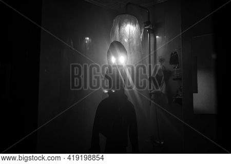 Halloween Concept. Horror Silhouette Of Person In Shower Cabin. Killer Maniac Inside Bathroom With G