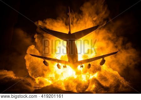 Air Crash. Burning Falling Plane. The Plane Crashed To The Ground. Decorated With Toy At Dark Fire B