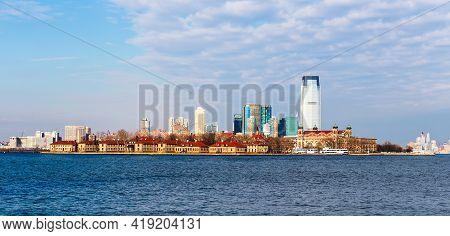 Ellis Island In New York Harbor Before Jersey City Skyline, New York