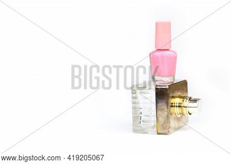 Pink Nail Polish Small Glass Bottle And Perfume Spray Bottle. Layout Stack Of Two Unbranded Cosmetic