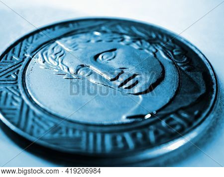 Brazilian 1 One Real Coin Close-up. Blue Dramatic Tinted Illustration About Money, Finance, Banking