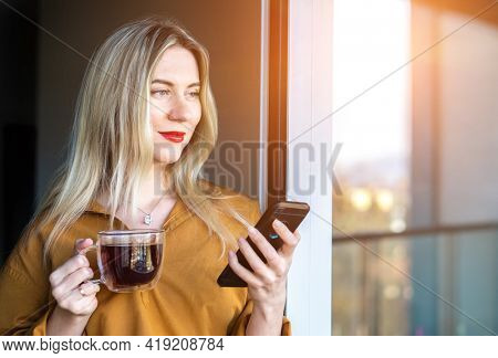 Businesswoman with smartphone, talking video call. Online chat with family, work colleagues, friends. Long distance communication. Staying connected, Social distancing, stay home, face time. Work life