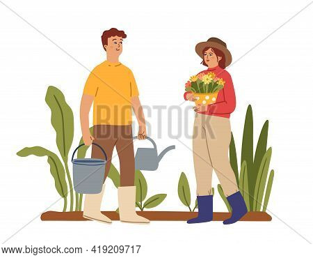 Gardeners. People In Garden, Planting Season. Green Plants, Woman Hold Flowers In Pot. Man With Buck