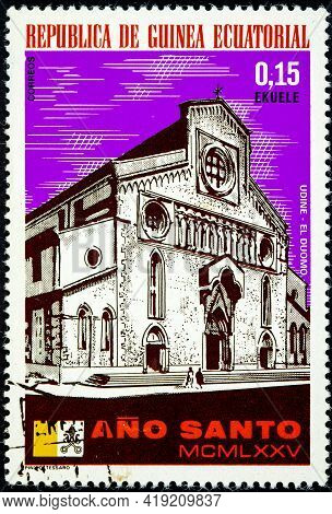 Equatorial Guinea - Circa 1975: A Stamp Printed In Equatorial Guinea, Holy Year Shown Udine, The Duo