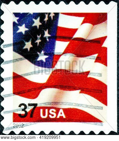 United States - Circa 2002: A Postage Stamp Printed In The United States, Features Waving Us Flag, F