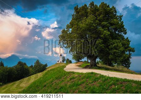 Majestic Scenery With Cute Church On The Mountain Ridge. Sunset Scenery And Famous Charming Saint Pr
