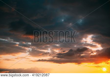 Sunset Cloudy Sky With Fluffy Clouds. Sunset Sky Natural Background. Sunrays, Sunray, Ray, Dramatic