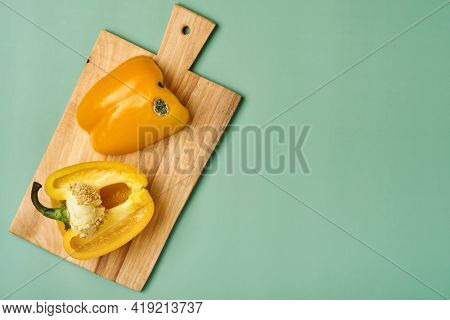Moldy And Wrinkled Rotten Cut In Half Yellow Peppers. Concept Of Unhealthy, Decompose, Spoiled Veget