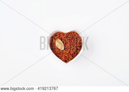 Saffron Spices Threads In Heart Shaped Plate Isolated On White Background. Top View. Saffron Flavor