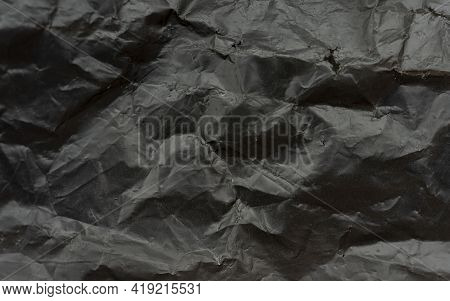 Black Plastic Bag Texture And Background, Corrugated Garbage Bag In High Resolution, Close-up Fragme
