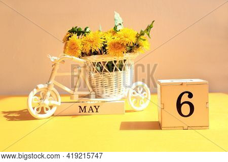 Calendar For May 6 : A Cube With The Number 6, The Name Of The Month Of May In English, A Bicycle Wi