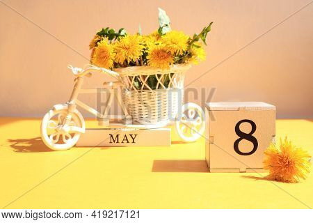 Calendar For May 8 : A Cube With The Number 8, The Name Of The Month Of May In English, A Bicycle Wi
