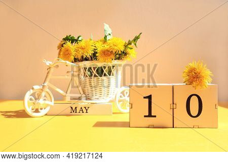 Calendar For May 10: Cubes With The Number 10, The Name Of The Month Of May In English, A Bicycle Wi