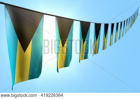 Beautiful Feast Flag 3d Illustration  - Many Bahamas Flags Or Banners Hangs Diagonal On Rope On Blue