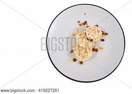 Top View Of Grey Plate With Appetizing Dietary Sweet Cheesecakes Sprinkled With Raisins On White Bac