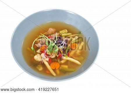 Close Up Of Blue Plate With Healthy Appetizing Vegetable Soup. Concept Of Soup With Different Vegeta