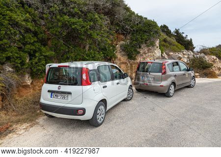 Antiparos Island, Greece - 28 September 2020: Two Cars, White Fiat Panda And Brown Nissan Note Parke