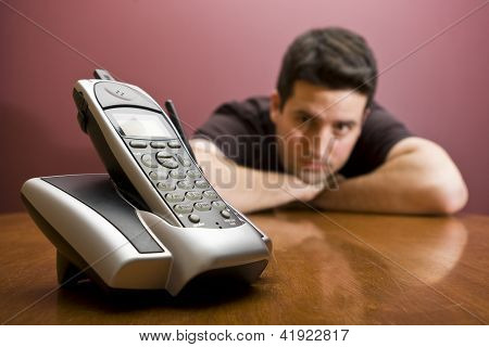 Man Looks At The Phone. Waiting