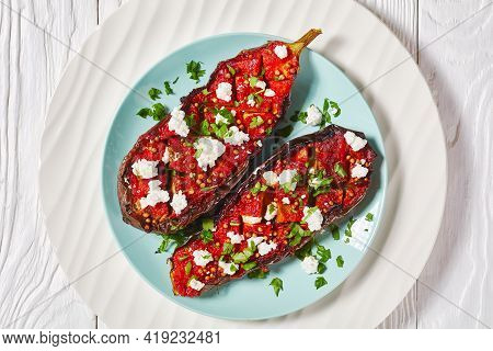 Imam Bayildi With Crumbled Feta, Eggplants Stuffed With Savory Tomatoes, Onions And Spices On A Plat