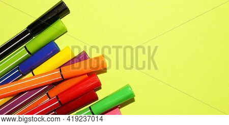 Markers Of Different Colors On A Yellow Background, View From Above. Imagination, Creativity, Art. T