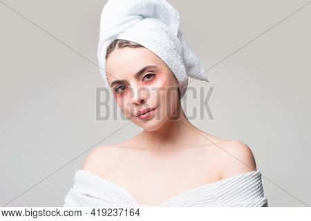 Portrait Of Beauty Woman With Eye Patches Showing An Effect Of Perfect Skin. Brunette Spa Girl. Eyes