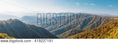 Panoramic Views Of Amazing Mountains And Yellow-orange Trees In Autumn. The Caucasus Nature Reserve