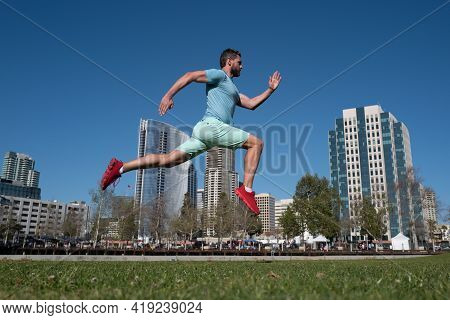 Runner Man Training Outside. Caucasian Male Athlete Jogging In San Diego City. Fit Young Jogger Runn