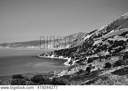 Rocky Coast On The Island Of Cephalonia In Greece, Monochrome