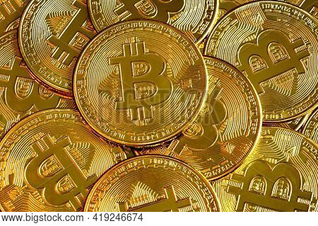 Bitcoin Pile Background, Digital Crypto Currency Bitcoin Close-up. Many Of Gold Bit Coins As Virtual