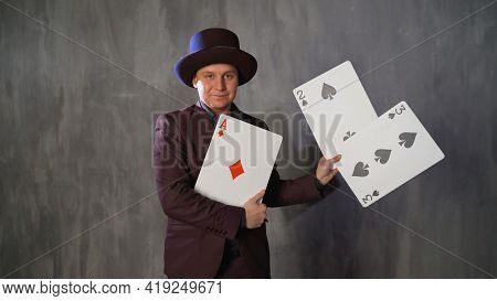 Magician With Playing Cards And Hat. Magician With Playing Cards.