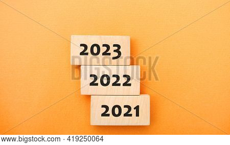 Wooden Blocks 2021, 2022, 2023. The Concept Of The Beginning Of The New Year. New Goals. Next Decade