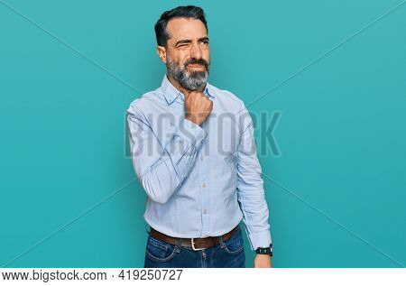 Middle aged man with beard wearing business shirt touching painful neck, sore throat for flu, clod and infection